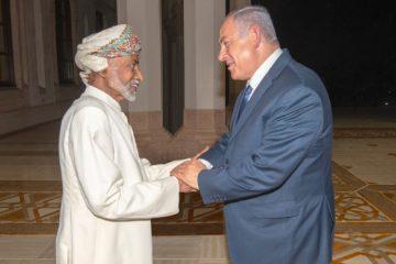 Oman's Sultan Qaboos, left, receives Israeli Benjamin Netanyahu. (Israeli Prime Minister's Office via AP)