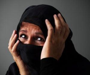 woman in burka in distress